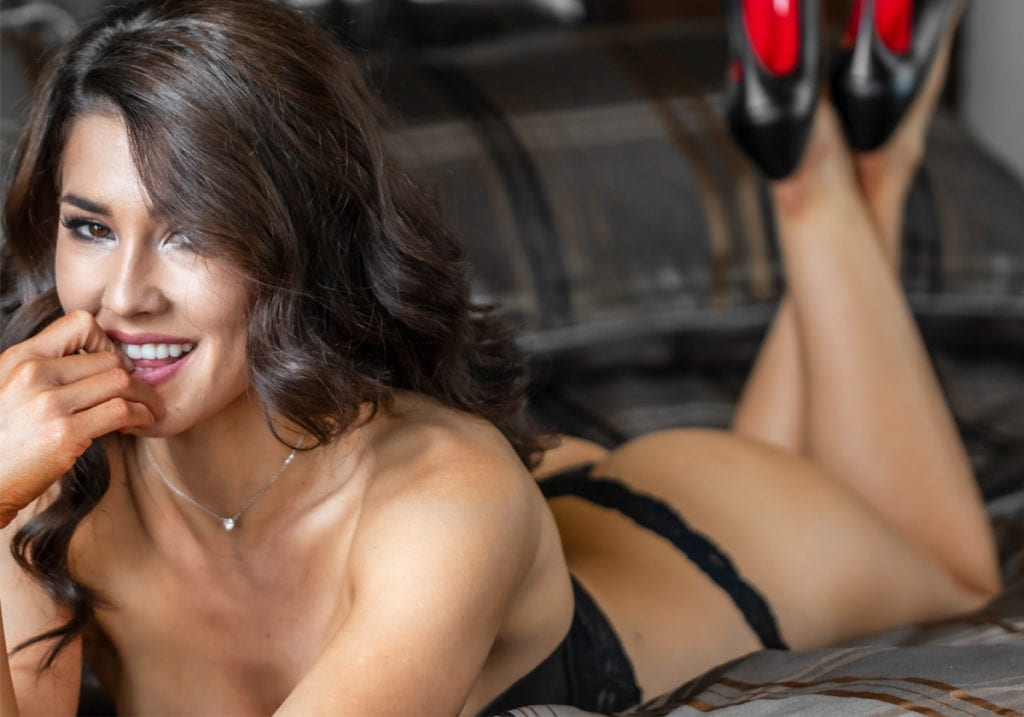 Woman in black lingerie in rental home